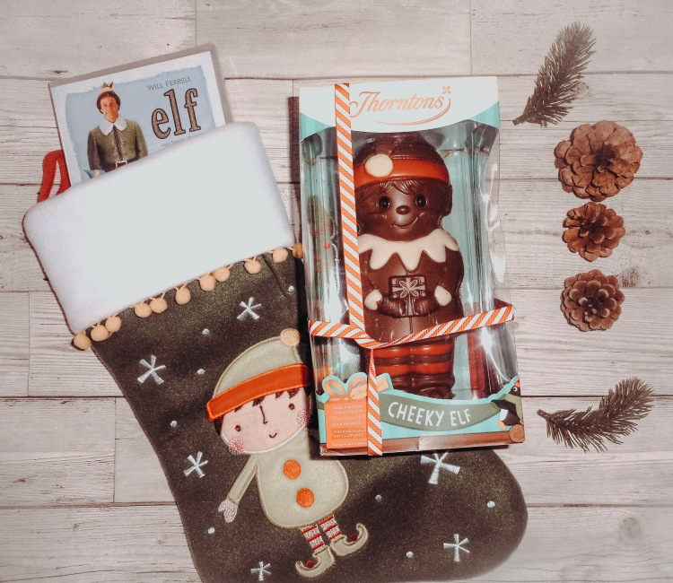 christmas flatly with elf movie and chocolate stocking
