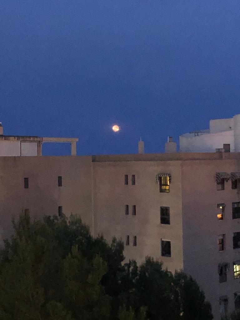 Red full moon over Benidorm Spain