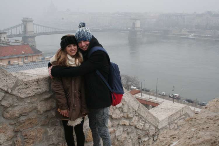 budapest travel guide buda castle view of the danube and chain bridge boy hugging girl