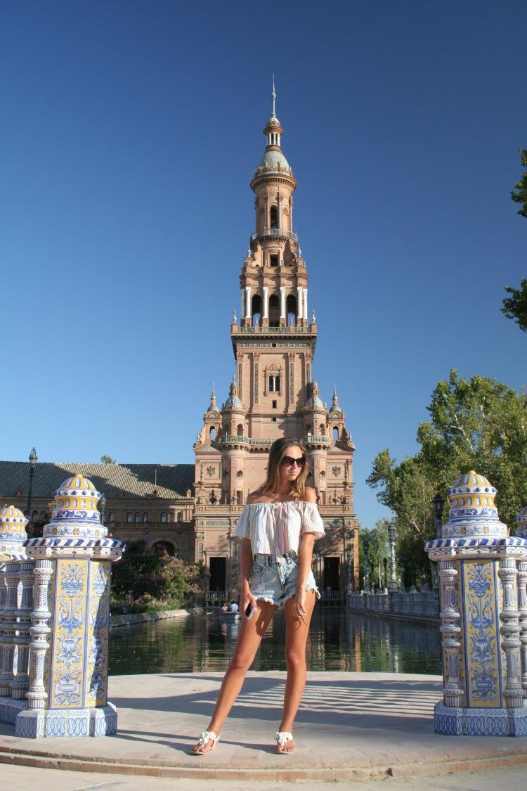 Girl standing in plaza de España Seville