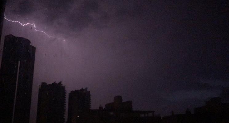 Lightning hitting el tempo building in Benidorm gota fría storm