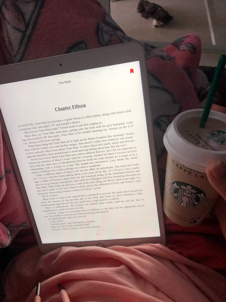 Trying to read my book with Starbucks coffee