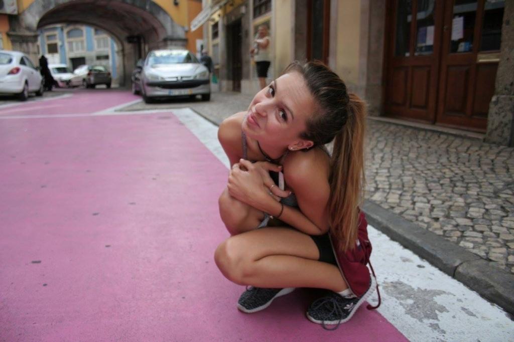 Girl and pink street Lisbon