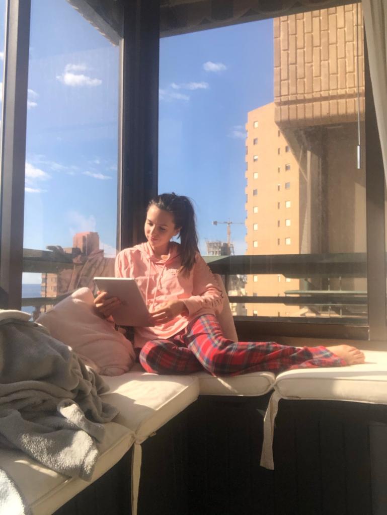 Reading on the balcony Benidorm lockdown