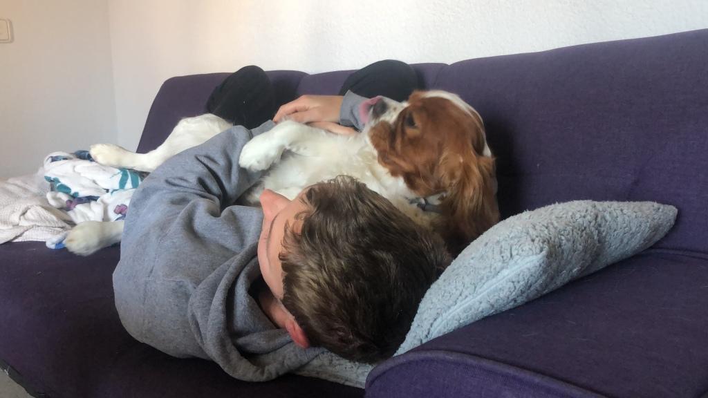 Cuddling the dog