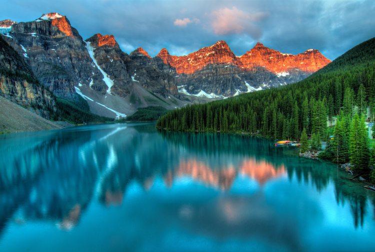 alberta lake with orange mountains