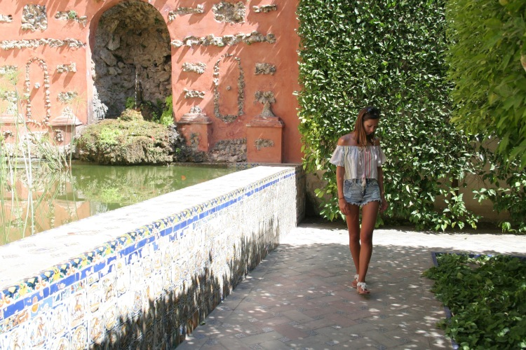 Girl walking with head down in Alcazar de Sevilla