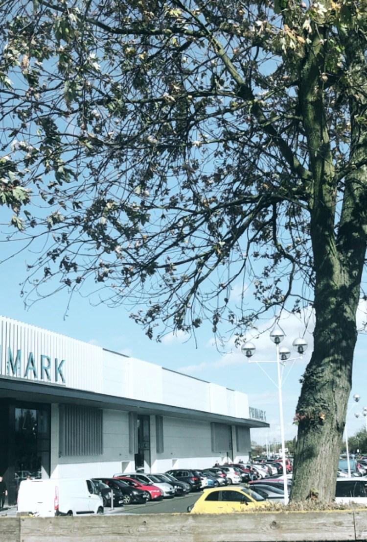 fosse park in autumn with primark