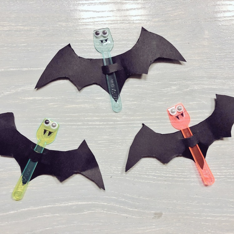 3 bats made with plastic, google eyes and paper