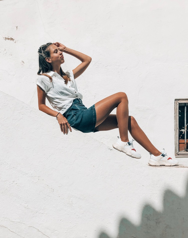 laying on wall tommy hilfiger denim skirt, white shirt altea spain 2019