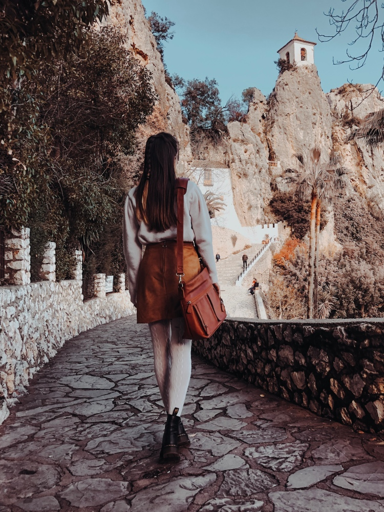 Girl looking at guadalest castle