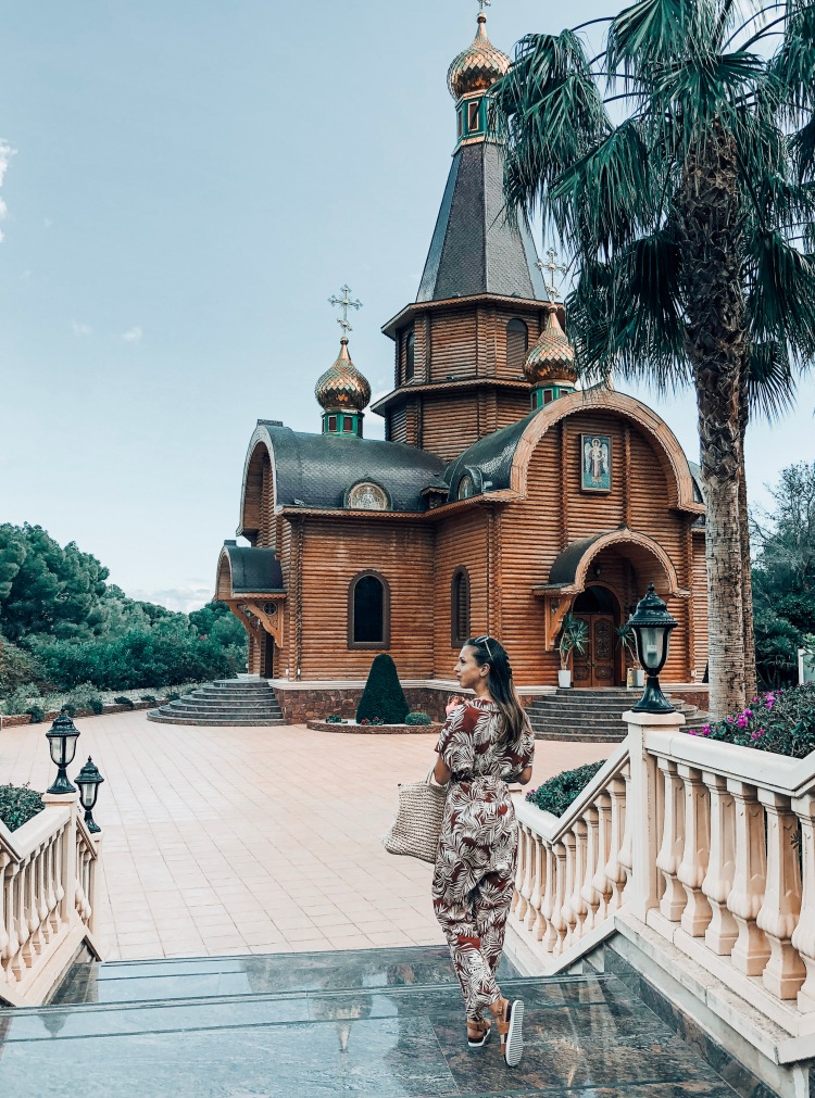 outside russian orthodox church with jumpsuit spring styles