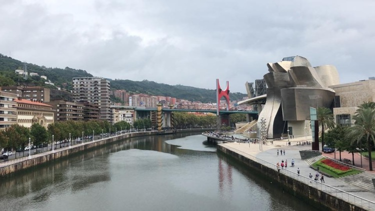 view of guggenheim museum bilbao and river spain