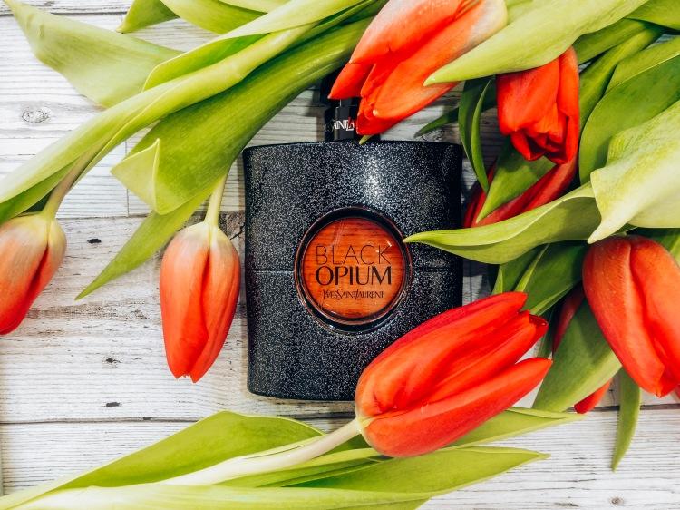 black opium flatlay tulips