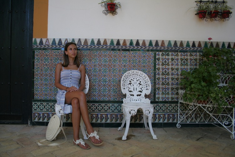 Sitting at palacio de las dueñas Seville Spain travel guide