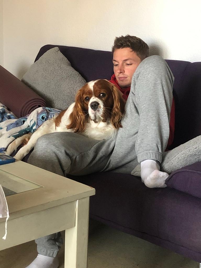 Rio sitting with Alex on sofa