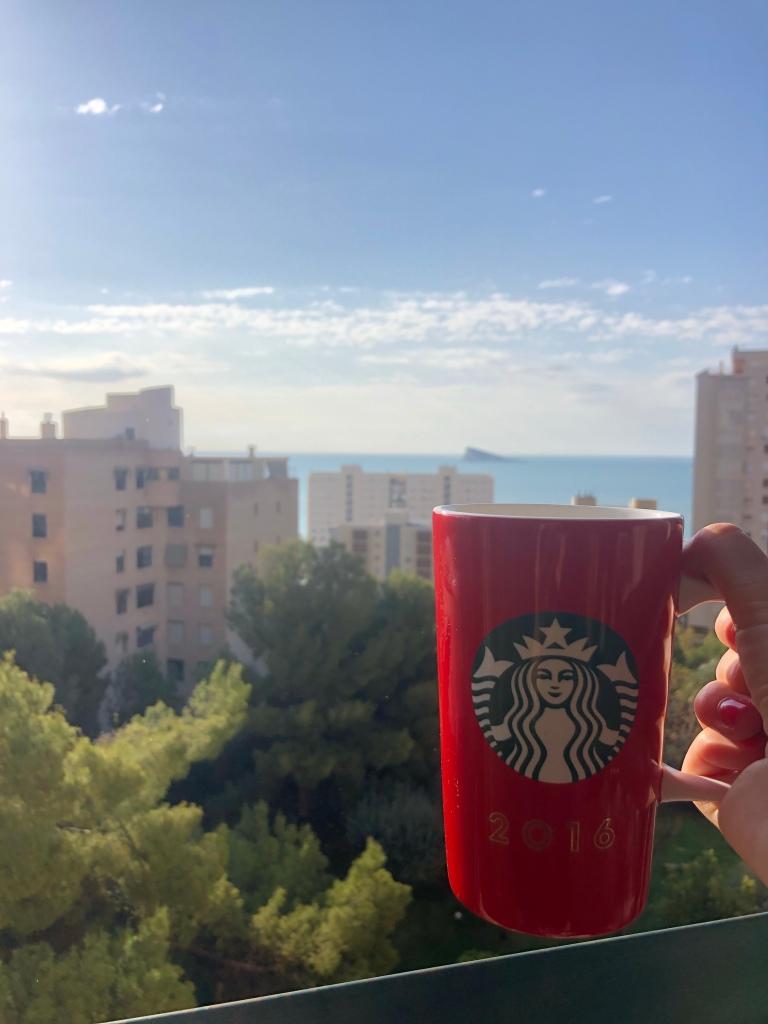 Having a tea overlooking beach