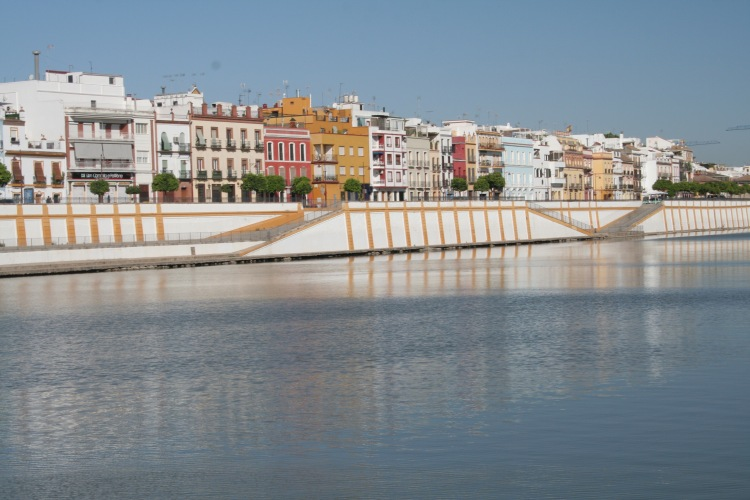 coloured houses lining the river in seville spain
