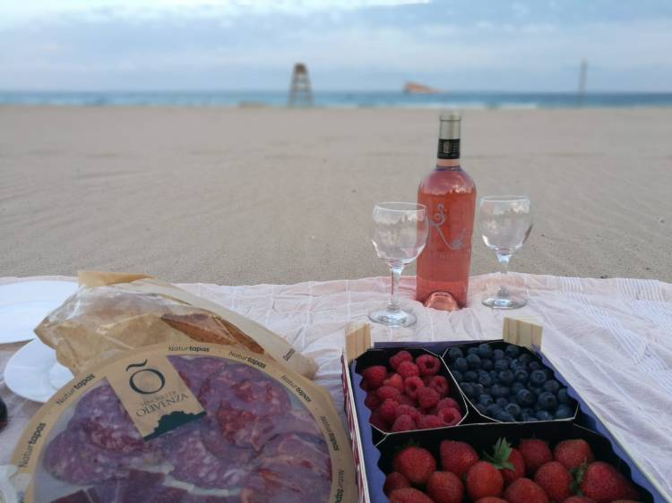 Picnic of Fruit, Ham and Pastry Shells and a bottle of wine
