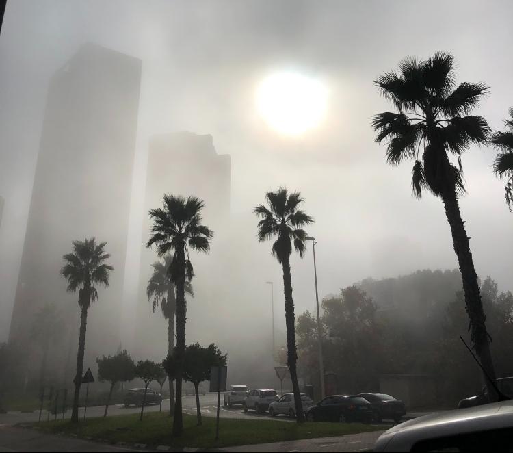sea fret fog in benidorm weather in december building hidden