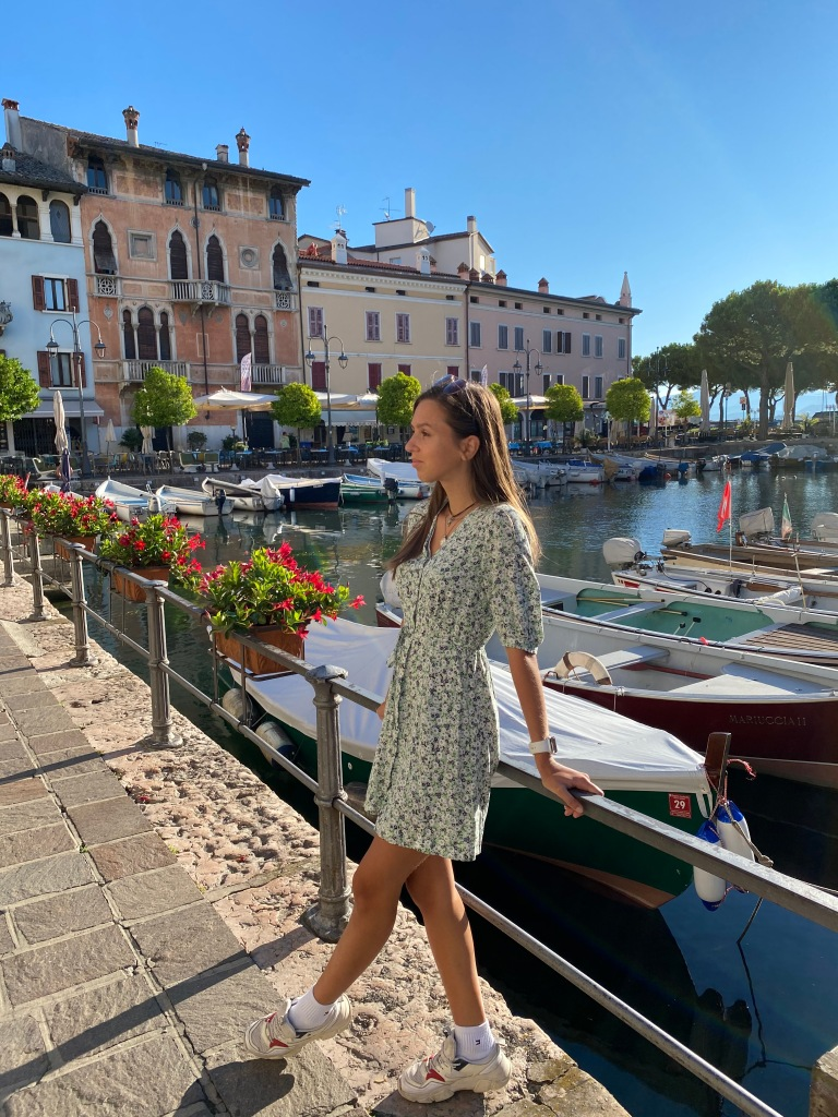 desenzano del garda travel guide lauren standing in front of boats at the small harbour