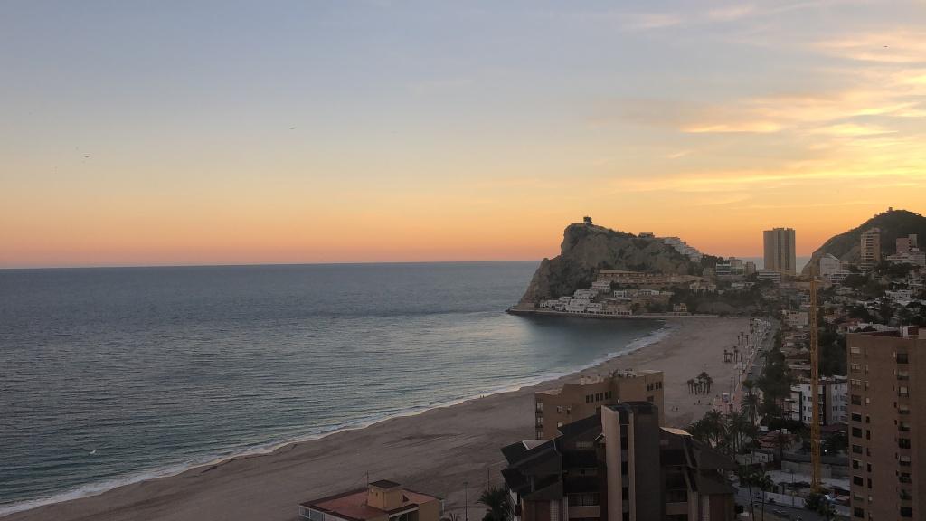 sunset over poniente beach benidorm