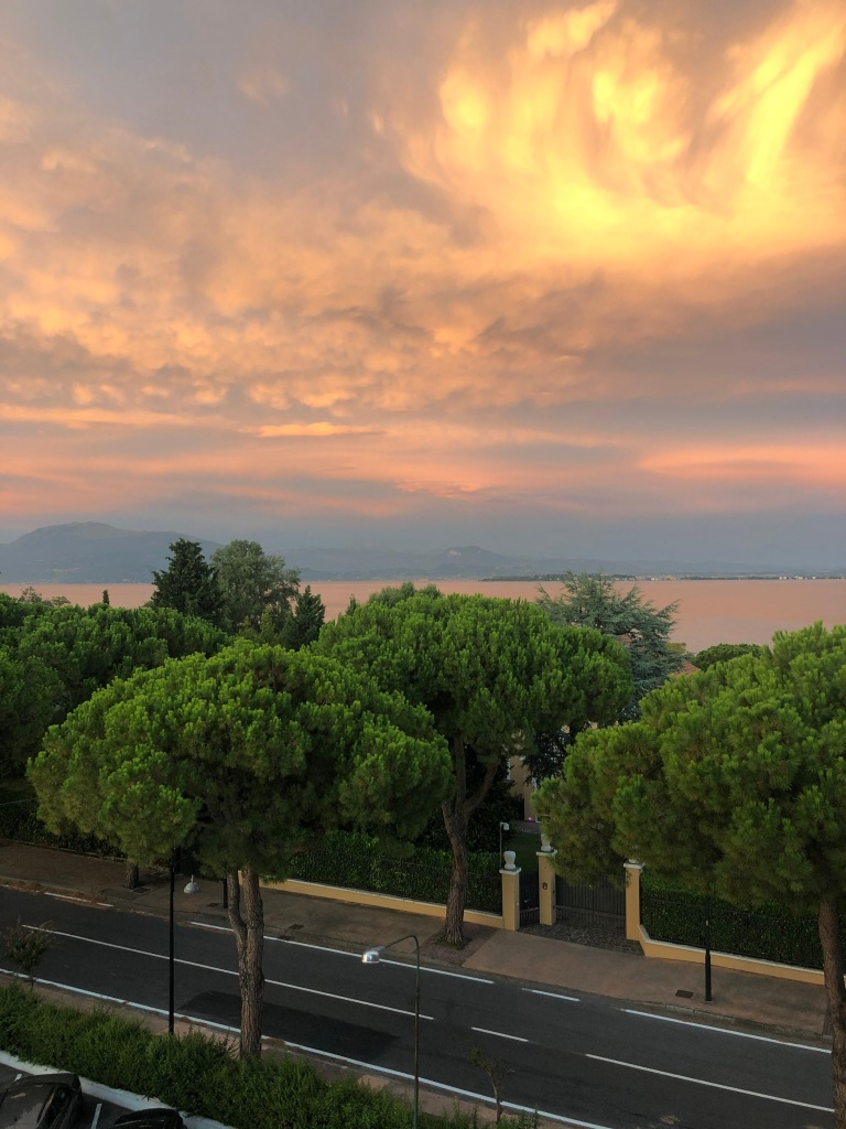 beautiful sunset over desenzano del garda travel guide