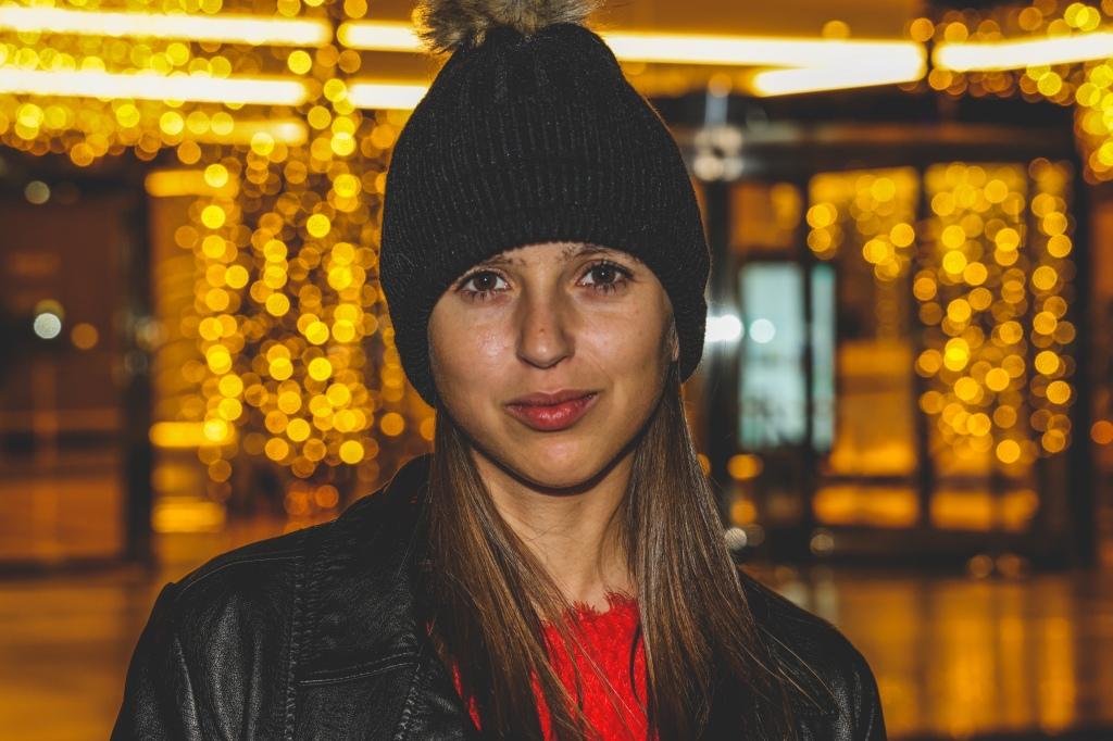 Girl looking forward Christmas lights behind at Alicante