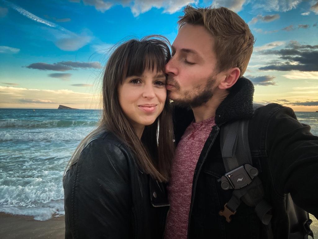 Boy kissing girl at sunset Benidorm