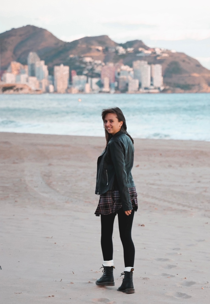 The sea has healing effects Lauren diary of a Spanglish girl walking along poniente beach with benidorm in the background